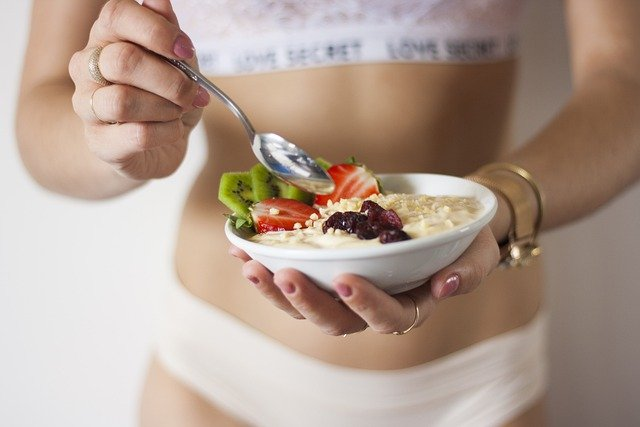 Woman with Yogurt Calorie Counting Weight Loss