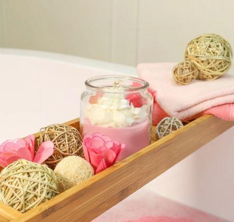 Candle Sitting Over Bathtub
